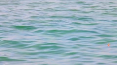 Red float on  sea water surface  background  with small  waves Stock Footage