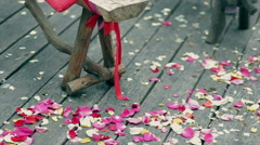 Wedding decoration, colorful petals of roses on wooden boards Stock Footage
