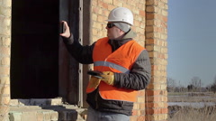 Construction employee filmed with tablet PC Stock Footage