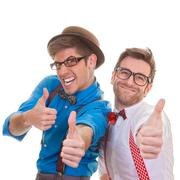 humour, business men with thumbs up for success - stock photo