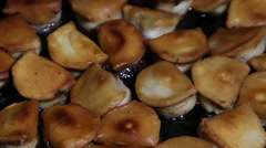 Homemade pelemen are fried on a frying pan Stock Footage