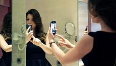 Pretty, elegant woman taking selfie photo with cellphone in the bathroom HD - stock footage