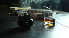 Tabacco pipe smoke whiskey Stock Footage