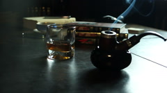 Tabacco pipe, whiskey and smoke Stock Footage