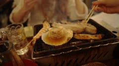 Close up table barbecue, from a Japanese fish barbecue restaurant in Tokyo Stock Footage