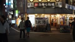 Exterior from a Japanese fish barbecue restaurant in Tokyo Stock Footage