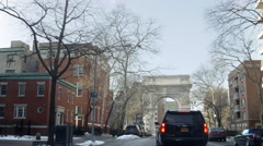 Cars driving Washington Square Park Arch Lower 5th Ave slow motion 4K Manhattan  Stock Footage