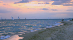 Sailboats Racing in Lake Ontario People on Beach Stock Footage