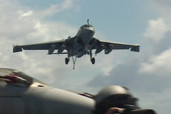 EA-6B prowler landing on aircraft carrier Stock Footage