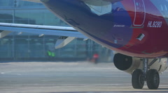 Asiana Airlines Aibus 321 getting to the start Stock Footage