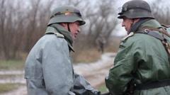 German soldiers dispute (rack focus). WW2 reconstruction - stock footage
