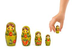 Hand and russian toy matrioska Stock Photos