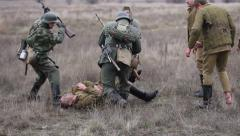 German soldiers beating with rifle butts the Soviet soldier Stock Footage
