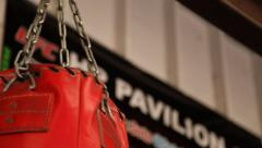 Boxing Gym - Dolly shot of punching bags Stock Footage