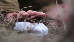 Soviet soldier raises a fallen handkerchief with the initials of his wife - stock footage