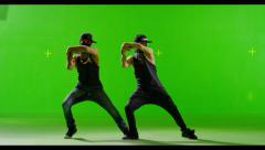 Modern Hip-Hop dancers dancing in masks. On Green screen. Stock Footage
