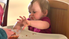 Adorable little girl eats spaghetti by herself for the first time, 4K Stock Footage