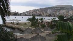 Saranda bay behind palm-trees Albania Stock Footage
