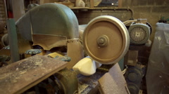 Machine is sanding the clogs from a wooden block. [Slomo] Stock Footage
