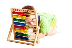 Jolly baby boy with abacus isolated on white background Stock Photos