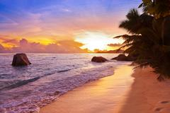 Sunset on beach Source D'Argent at Seychelles Stock Photos