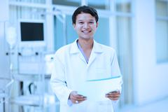 asian doctor portrait at hospital - stock photo