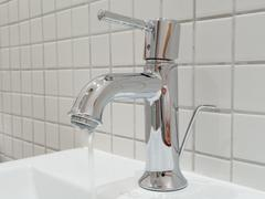 Silver faucet - stock photo