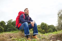 Smiling man with backpack hiking Stock Photos