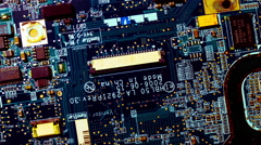 4K close up macro computer chips circuits surface rotating dolly Stock Footage