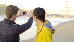 Mixed Race Gay Couple Stop To Take A Photo Of The Golden Gate Bridge Stock Footage