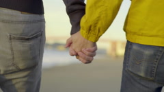 Gay Couple Hold Hands And Walk Down Beach Toward Golden Gate Bridge Stock Footage