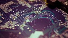 4K close up macro computer chips circuits surface rotating dolly Stock Footage