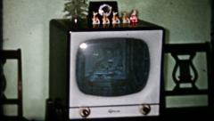 1741 - vintage television in living room - vintage film home movie Stock Footage