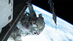 Astronaut Walk Working on International Space Station - stock footage