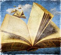 Old open books flying in the sky. Concept of freedom with reading. Stock Illustration