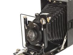 vintage photographic camera isolated on white background - stock photo