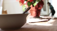 Woman cleaning up after a soup lunch Stock Footage