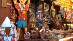 "Big Pinocchio at the storefront of the wooden toys shop ""Bartolucci"". Rome Stock Footage"
