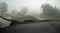 Driving rural street ice fog 1 Stock Footage
