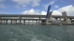 Ship under the bascule bridge in Biscayne Bay, Miami Stock Footage