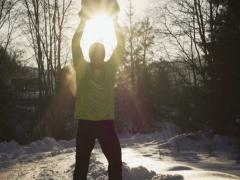 Man bringing up heavy snowball, steadycam shot, slow motion shot Stock Footage