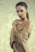 Woman in gold smart dress Stock Photos