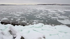 Ice chunks float through ocean harbor, Portland Maine Stock Footage