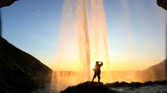 Iceland Seljalandsfoss sunset Waterfall rock face cliff hiking - stock footage