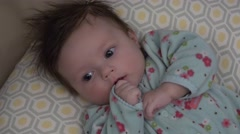 Baby Trying to Suck Thumb - stock footage