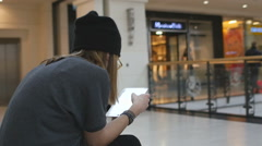 Girl using touchpad in the mall wifi area Stock Footage