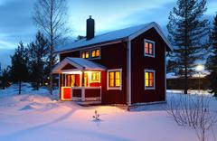Stock Photo of wooden house in Sweden during winter