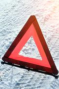 Warning triangle on road - stock photo