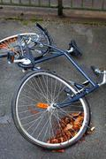 A bicycle with a buckled wheel from vandalism - stock photo