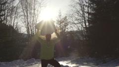 Happy man holding bid snowball, steadycam shot, slow motion shot at 240fps - stock footage